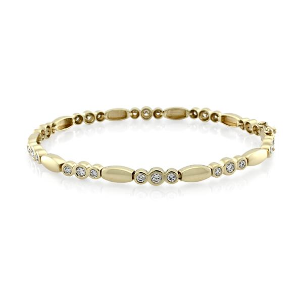 Yellow gold diamond bracelet designed with three rows of yellow gold plated small diamonds alternate with gold oval shaped charm