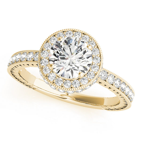 Yellow gold channel set round cut diamond ring with milgrain design surrounding the halo and upper shank