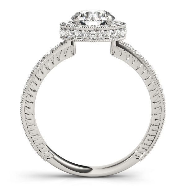 Front view of white gold round cut diamond ring revealing the side part of the ring with intricate design with milgrain design surrounding the shank and the halo