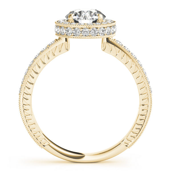 Front view of yellow gold round cut diamond ring revealing the side part of the ring with intricate design with milgrain design surrounding the shank and the halo