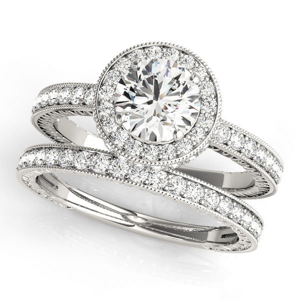 Round cut diamond ring with halo and a diamond wedding band in white gold