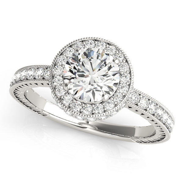 White gold channel set round cut diamond ring with milgrain design surrounding the halo and upper shank