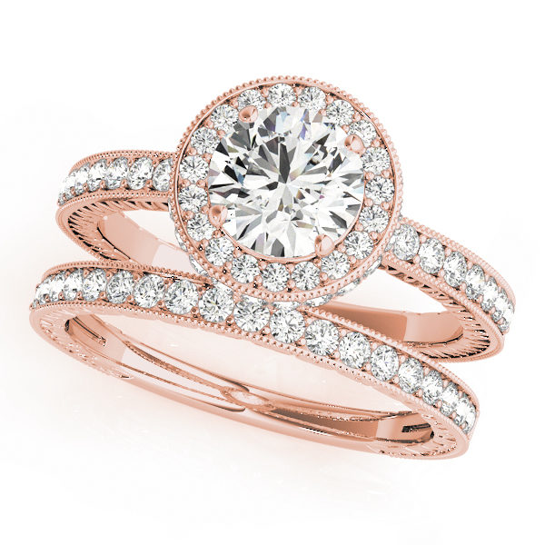 Round cut diamond ring with halo and a diamond wedding band in rose gold