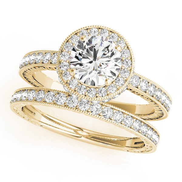 Round cut diamond ring with halo and a diamond wedding band in yellow gold