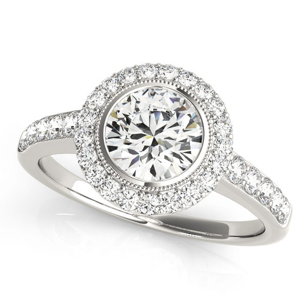 White gold round halo diamond ring with milgrain design surrounding the center stone with set of stones embedded on the upper shank