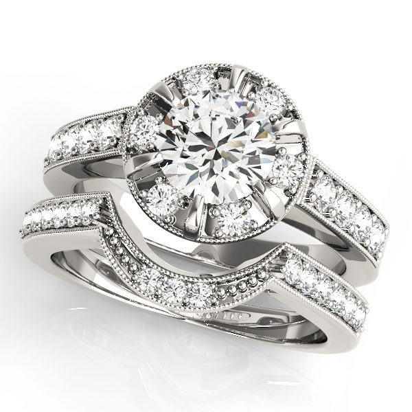 A halo round-cut diamond ring in a six-pronged ring setting with melee diamonds in a white gold with shared-pronged double band