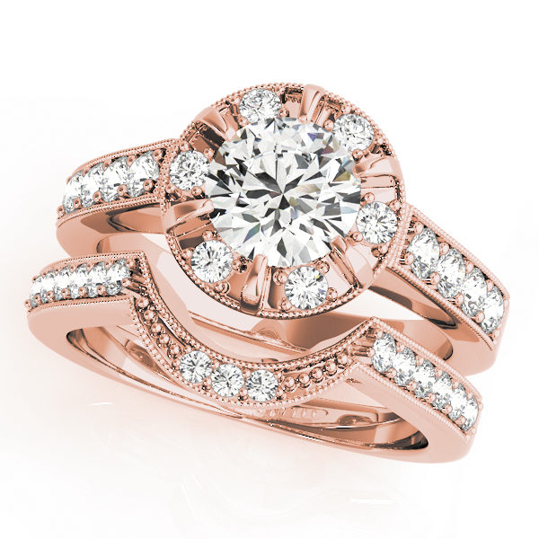 A halo round-cut diamond ring in a six-pronged ring setting with melee diamonds in a rose gold with shared-pronged double band