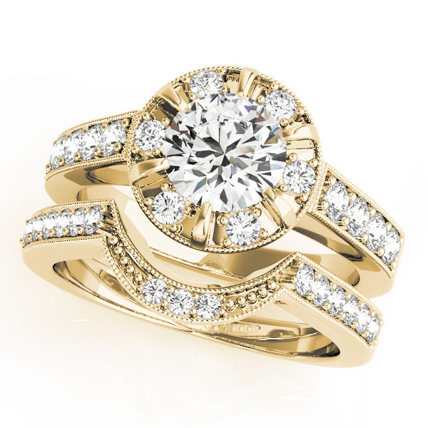 A halo round-cut diamond ring in a six-pronged ring setting with melee diamonds in a yellow gold with shared-pronged double band