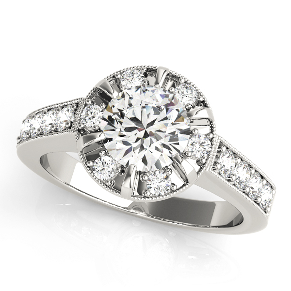 Halo round-cut diamond ring in a six-pronged ring setting with melee diamonds in a white gold with shared-pronged band