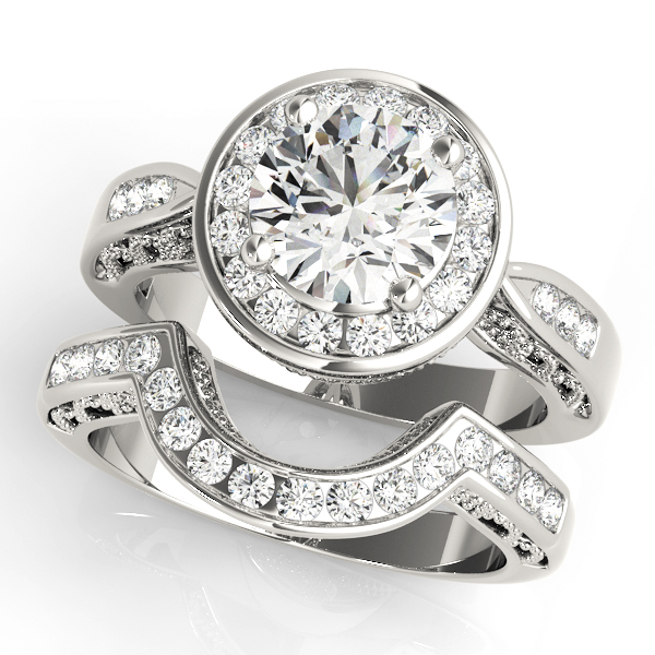 Wedding set of a unique engagement ring with channel set of halo diamonds and a wedding band in white gold