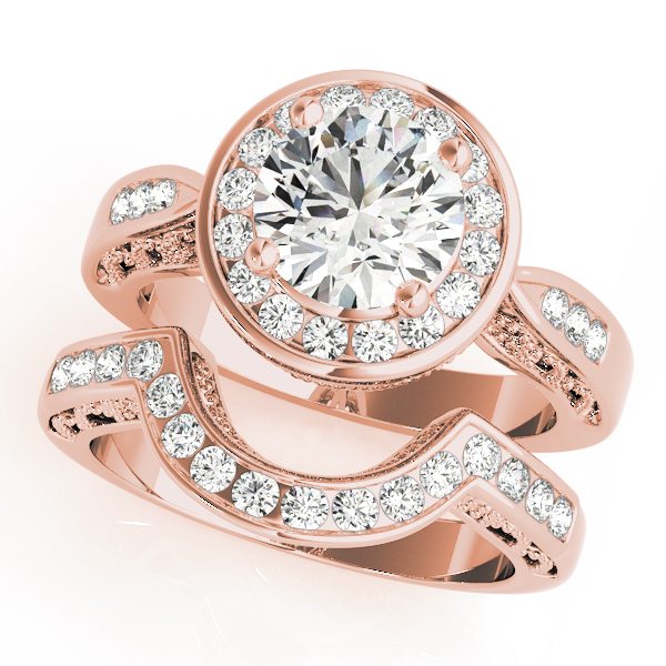 Wedding set of a unique engagement ring with channel set of halo diamonds and a wedding band in rose gold