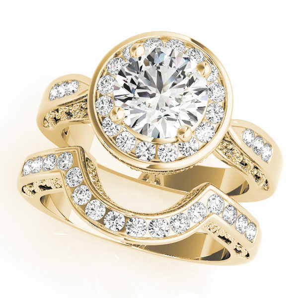 Wedding set of a unique engagement ring with channel set of halo diamonds and a wedding band in yellow gold