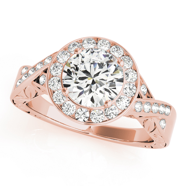 A diamond channel halo style engagement ring made of rose gold, decorated by twisting channet set bands.