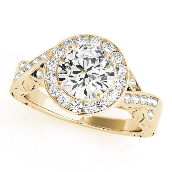 A diamond channel halo style engagement ring made of yellow gold, decorated by twisting channet set bands.