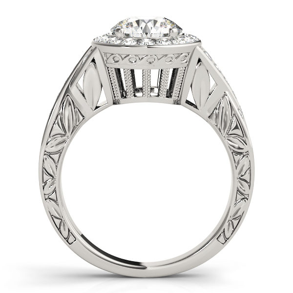Side view of a white gold halo engagement ring, with its upper shank embellished with leaves and a large under gallery.