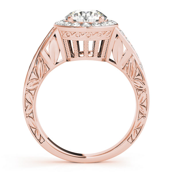 Side view of a rose gold halo engagement ring, with its upper shank embellished with leaves and a large under gallery.