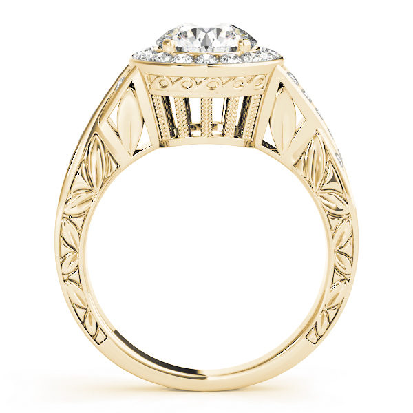 Side view of a yellow gold halo engagement ring, with its upper shank embellished with leaves and a large under gallery.