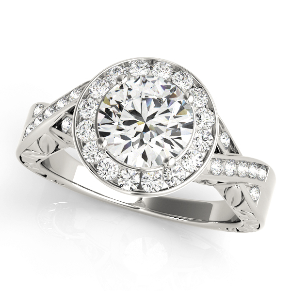 A diamond channel halo style engagement ring made of white gold, decorated by twisting channet set bands.
