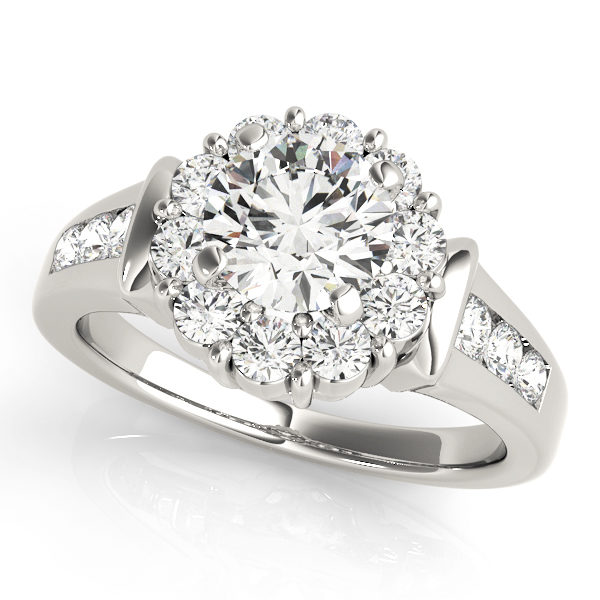 White gold round gold halo engagement ring with set of 3 small diamonds on each side of the upper shank