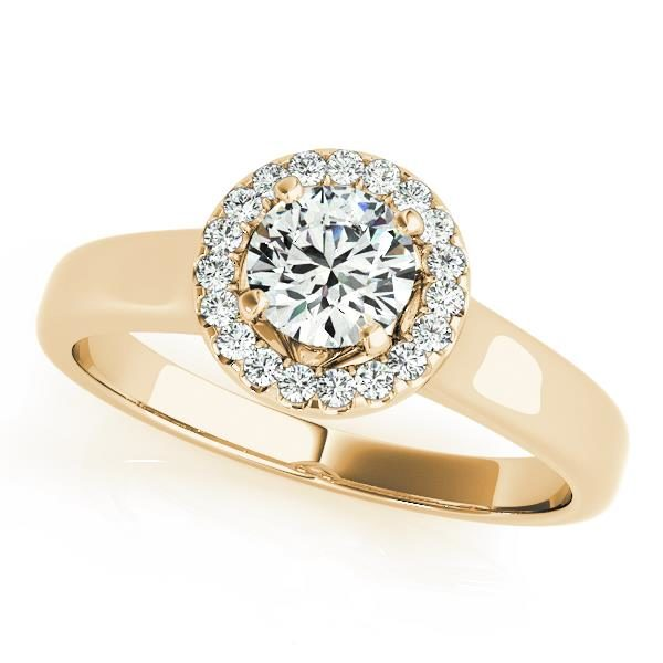 Round halo engagement ring in a yellow gold plain band