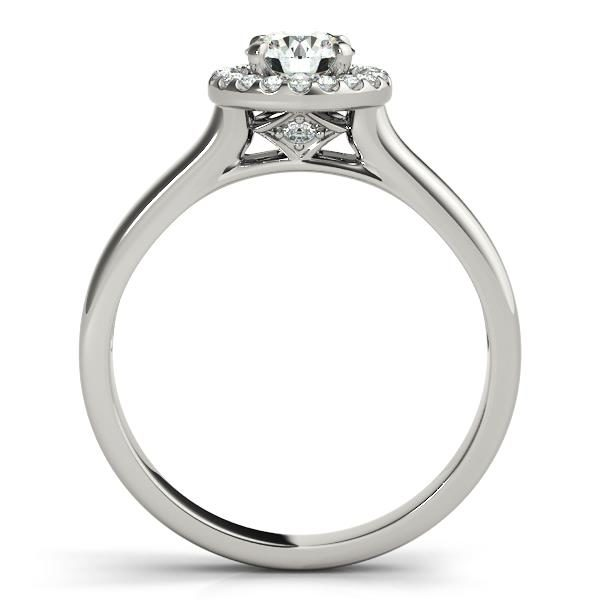 Front view of round halo engagement ring in a plain white gold band with a diamond shaped bridge