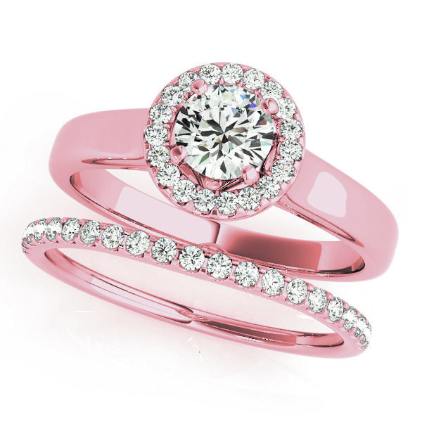 Wedding set of a round halo engagement ring in a plain band and a wedding band with row of small diamonds on upper part of the shank in pink gold