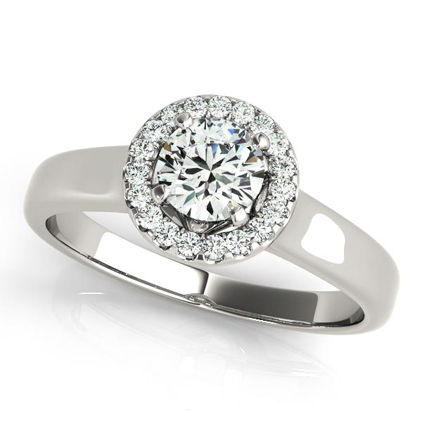 Round halo engagement ring in a white gold plain band