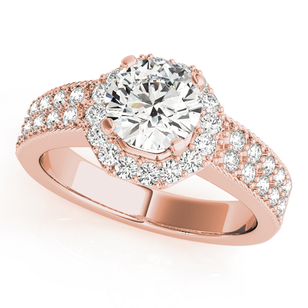 Rose gold twisted engagement ring with pave diamond on the band and a round diamond in a four-pronged setting