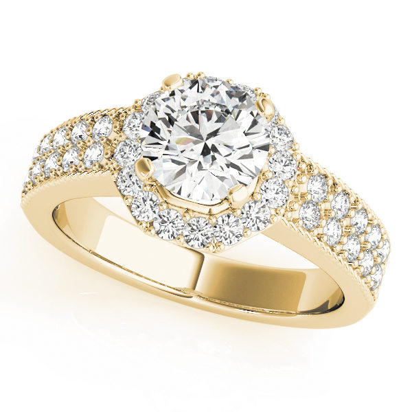 Yellow gold twisted engagement ring with pave diamond on the band and a round diamond in a four-pronged setting