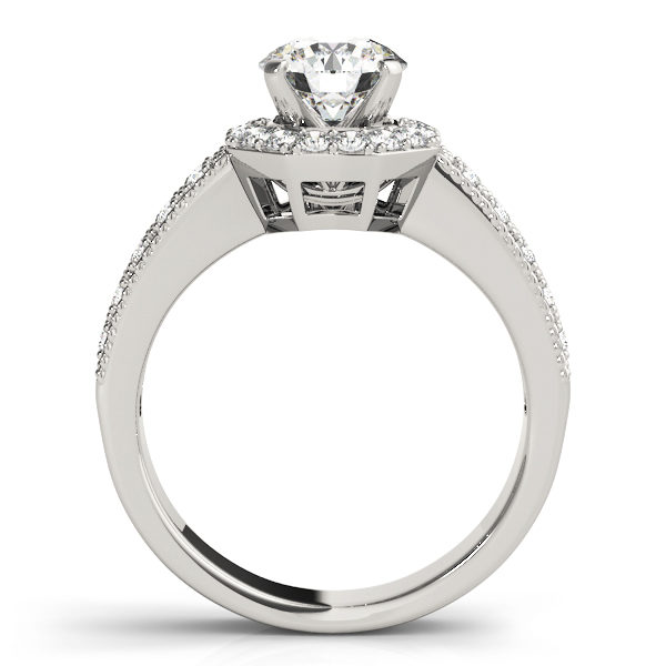 Side view of a white gold twisted engagement ring band with round cut diamond in a four pronged setting surrounded by halo diamonds with pave diamond band
