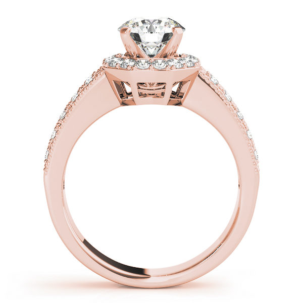 Side view of a rose gold twisted engagement ring band with round cut diamond in a four pronged setting surrounded by halo diamonds with pave diamond band