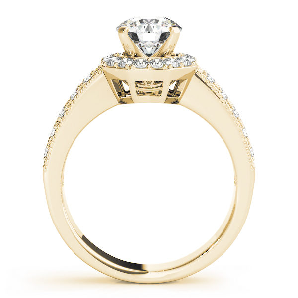 Side view of a yellow gold twisted engagement ring band with round cut diamond in a four pronged setting surrounded by halo diamonds with pave diamond band