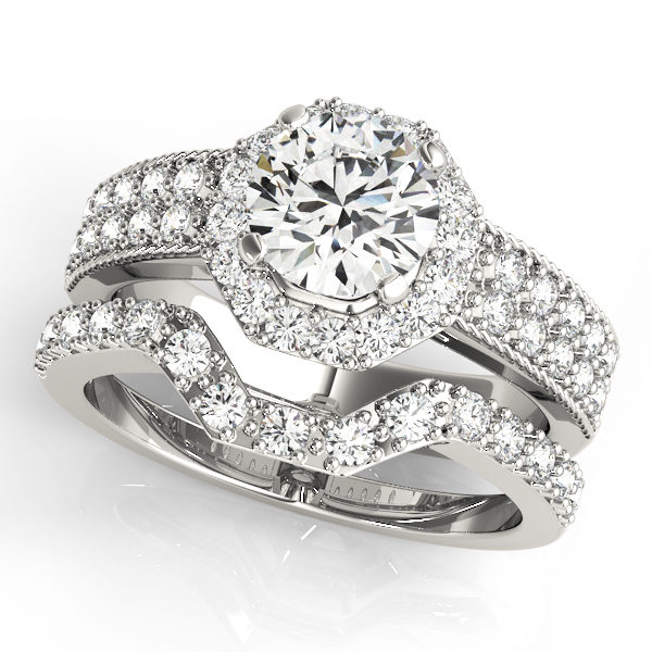 White gold double band twisted engagement ring with a round cut diamond in a four pronged setting surrounded by halo and pave diamonds