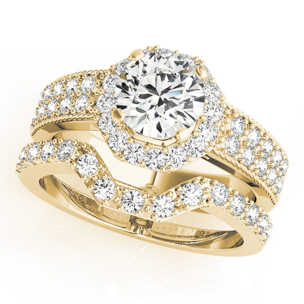 Yellow gold double band twisted engagement ring with a round cut diamond in a four pronged setting surrounded by halo and pave diamonds