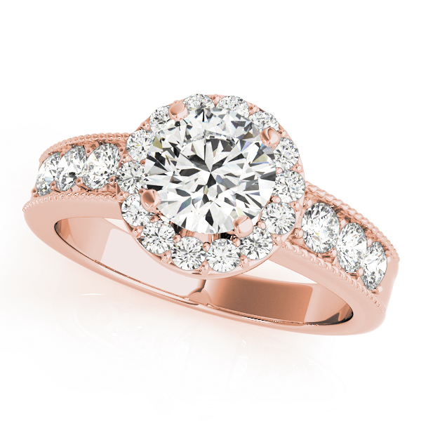 Rose gold engagement ring with round halo design and surface prong set side accents on the band