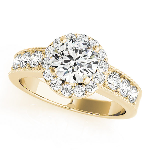 Yellow gold engagement ring with round halo design and surface prong set side accents on the band