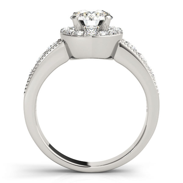 Side view of a white gold engagement ring with the gallery attached to the shank seamlessly and both accents filled surface prong set diamonds