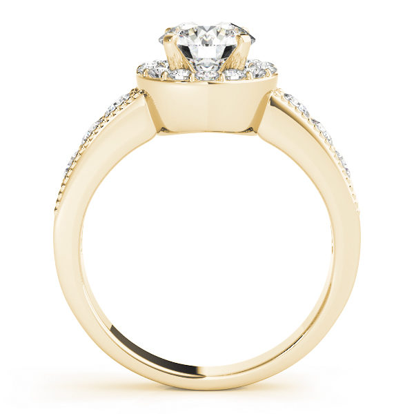 Side view of a yellow engagement ring with the gallery attached to the shank seamlessly and both accents filled surface prong set diamonds