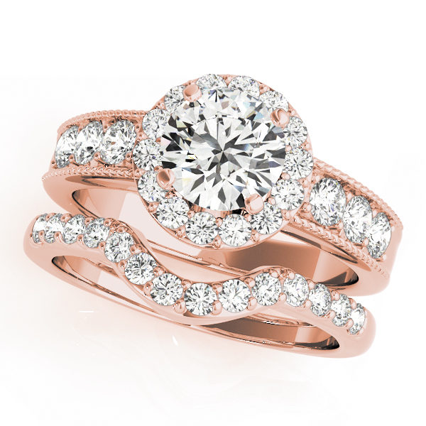 Wedding ring set made of rose gold consisting of a round halo engagement ring with a surface prong set side accents and a surface prong set wedding band with a curved center fitting the shape of the engagement ring