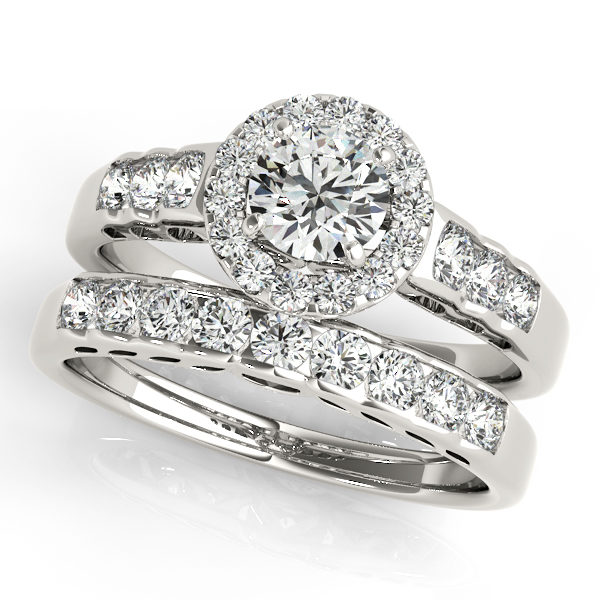 Set of round halo engagement rings and wedding band in white gold