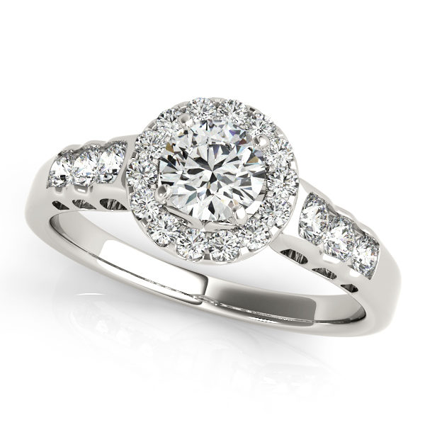 White gold halo engagement rings with three smaller diamonds on each side of the upper shank