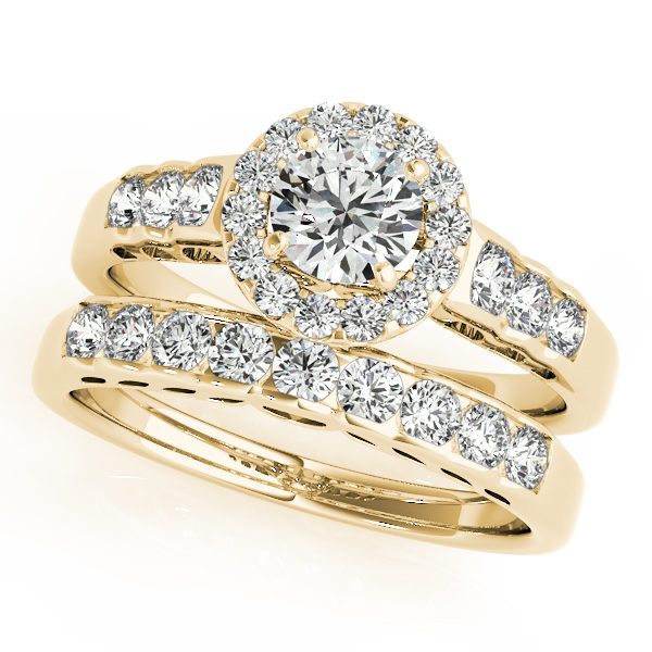 Set of round halo engagement rings and wedding band in yellow gold