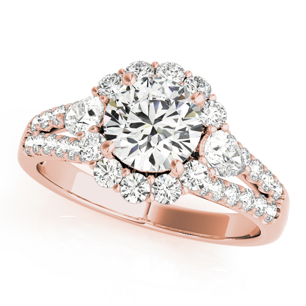 Halo round engagement ring with two pear shaped diamonds each side of the center diamond with row of small diamonds embedded on split shank in rose gold
