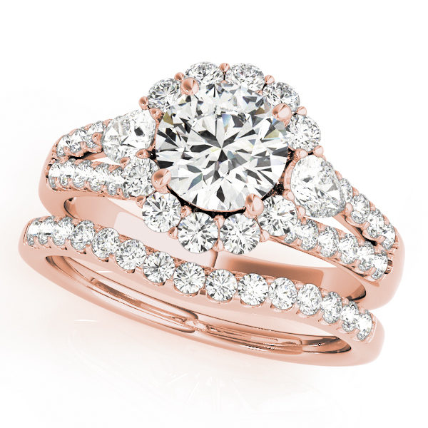 Halo round engagement ring with row of small diamonds embedded on split shank and diamond wedding band in rose gold