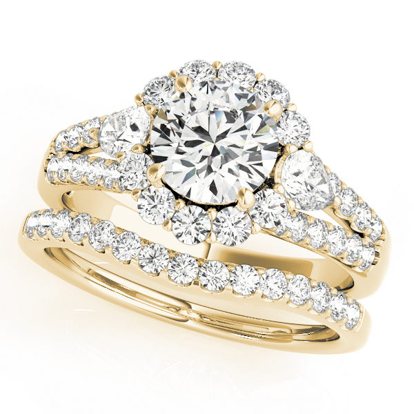 Halo round engagement ring with row of small diamonds embedded on split shank and diamond wedding band in yellow gold