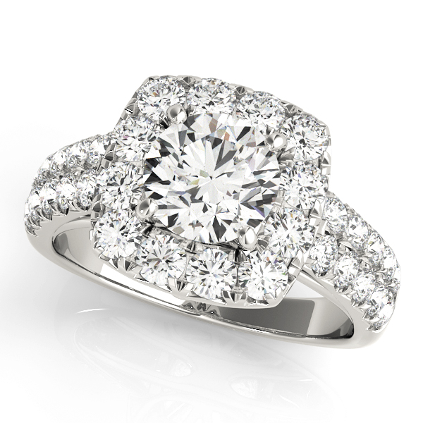 White gold square halo engagement ring with double row of surface prong ser diamond embellished band.