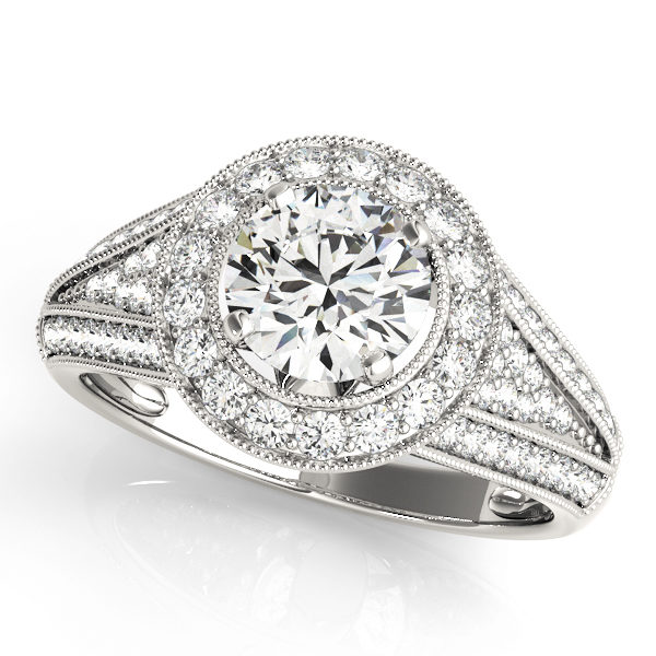 Split v band engagement ring set in pave style and a halo style centerpiece