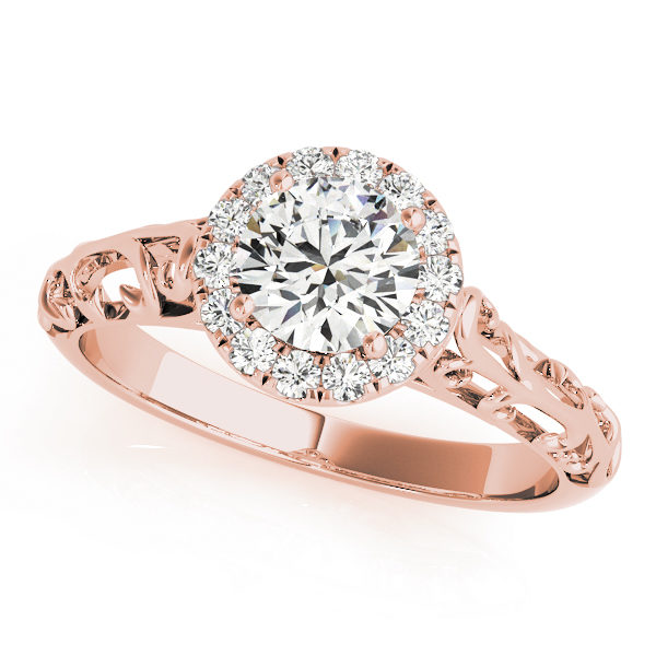 Rose gold engagement ring with a filigree design band and a pave halo style centre piece