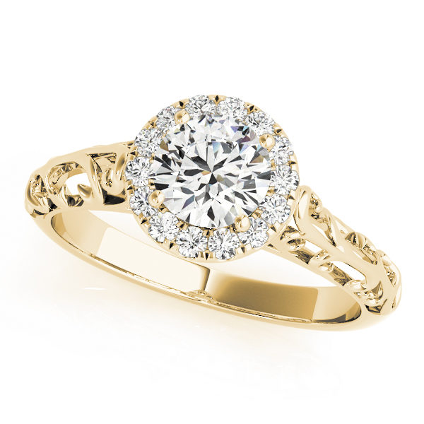 Yellow gold engagement ring with a filigree design band and a pave halo style centre piece