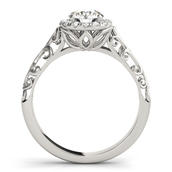 White gold engagement ring with a filigree design band, pave halo style centre piece and a petal under gallery standing upright